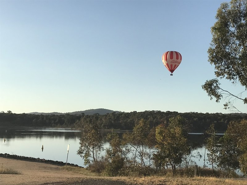 Early morning, balloon floating over Crusoe Reservoir.