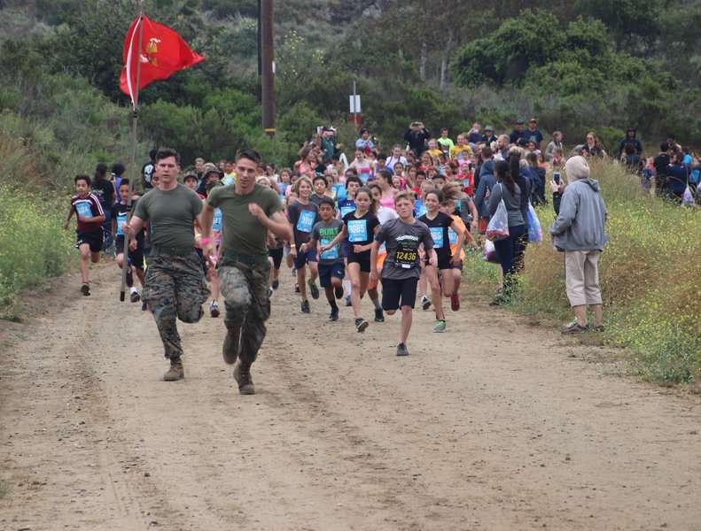 Marine Volunteers leading the kids for a run.