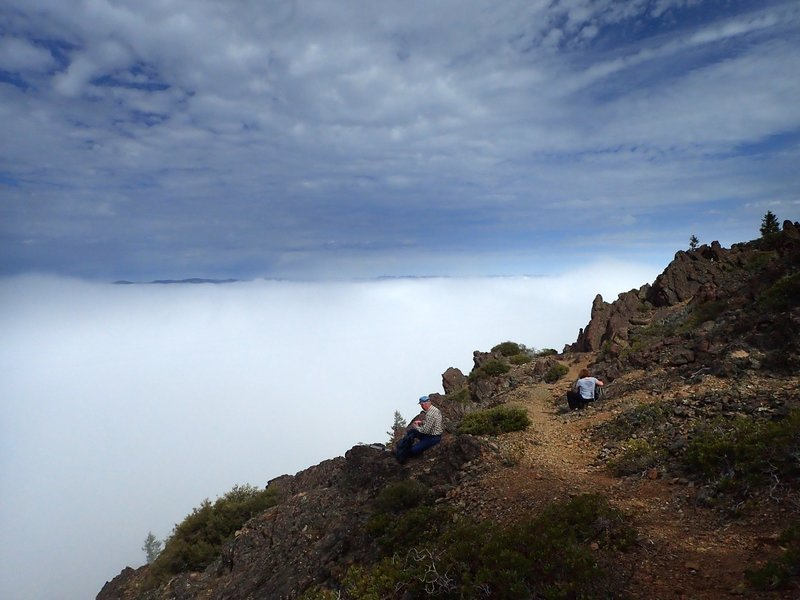 Above a sea of clouds at the end of the steep part of the trail