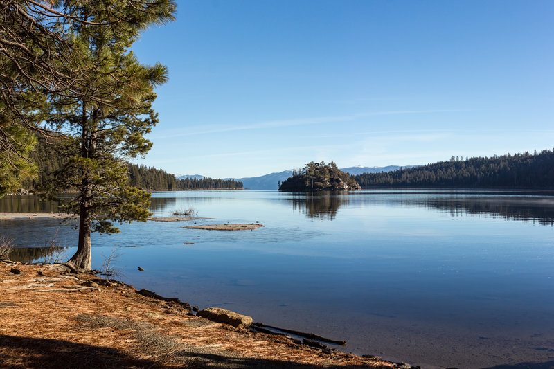 A thin layer of ice on the water in Emerald Bay with Fannette Island in the background