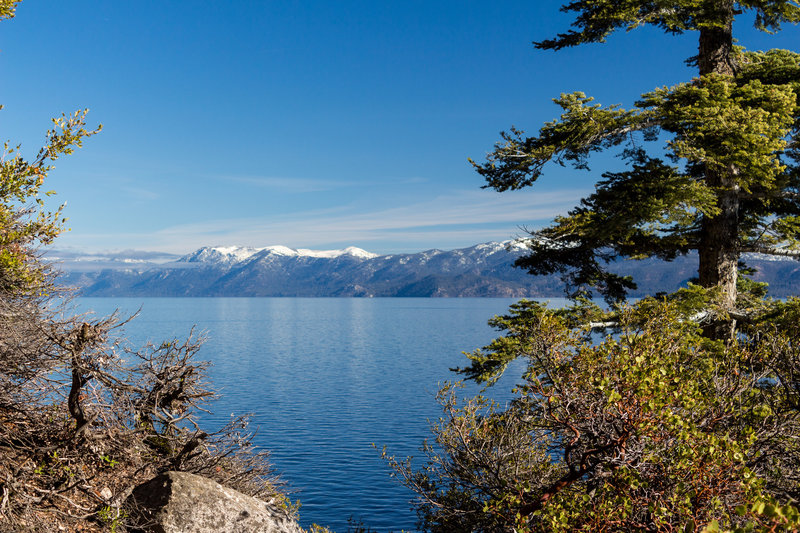 Snow covered mountains across Lake Tahoe from Rubicon Trail in D.L. Bliss State Park