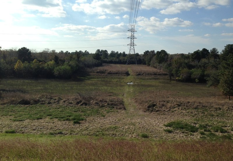 North end of the Power Line Ponds Trace looking west from the top of the dam.  The creek can generally be crossed if the reservoir is empty and if there have been no recent rains.