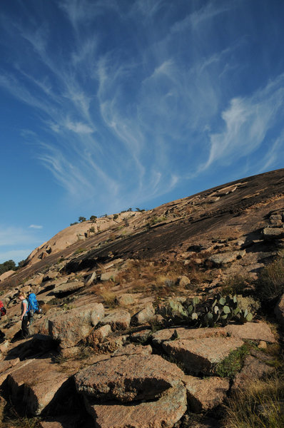 Hiking along Echo Canyon with Enchanted Rock in the background