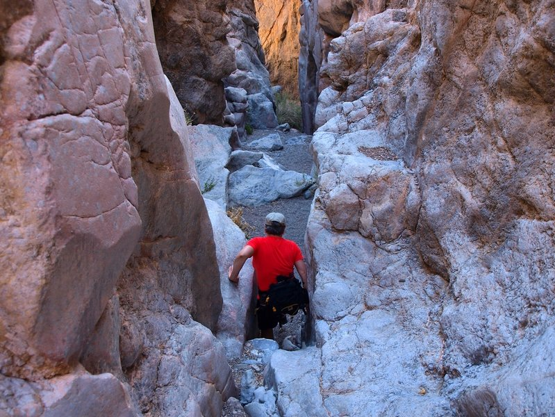 Crawling through the slit in Slit Canyon