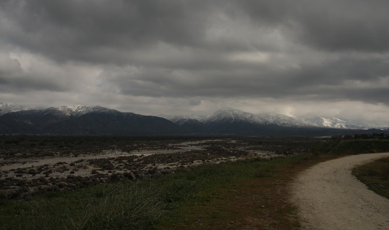 Stormy day, with snow in the mountains.