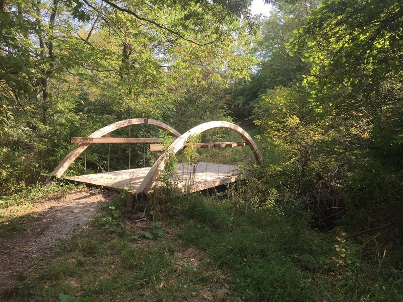 Footbridge with arches along the northeast to northwest trail in Hickory Hill Park.