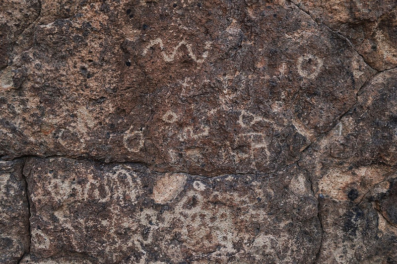 Faint petroglyphs visible along the Rings Loop Trail