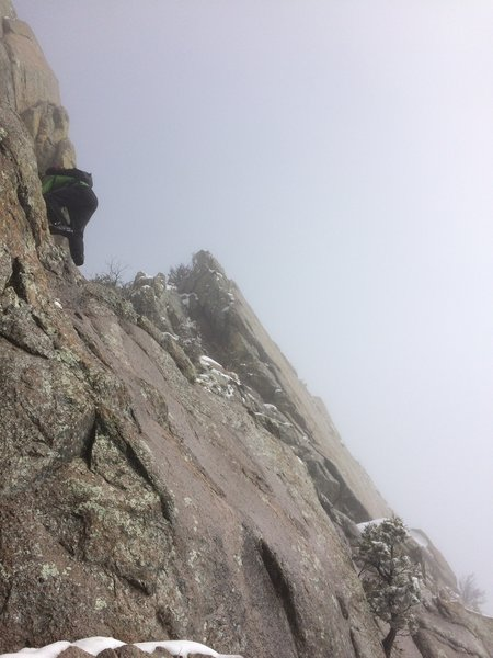 "Climbing the easy 6"" diagonal seam at the top of the gully."