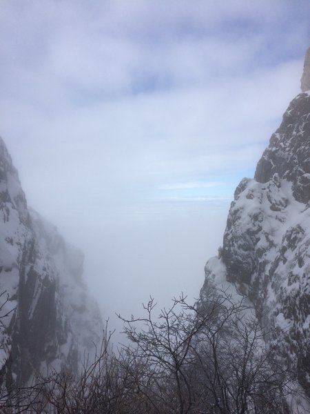 A cloudy view from the top of Dark Canyon - the narrow canyon only gets a few hours of sunlight each day, hence the name.