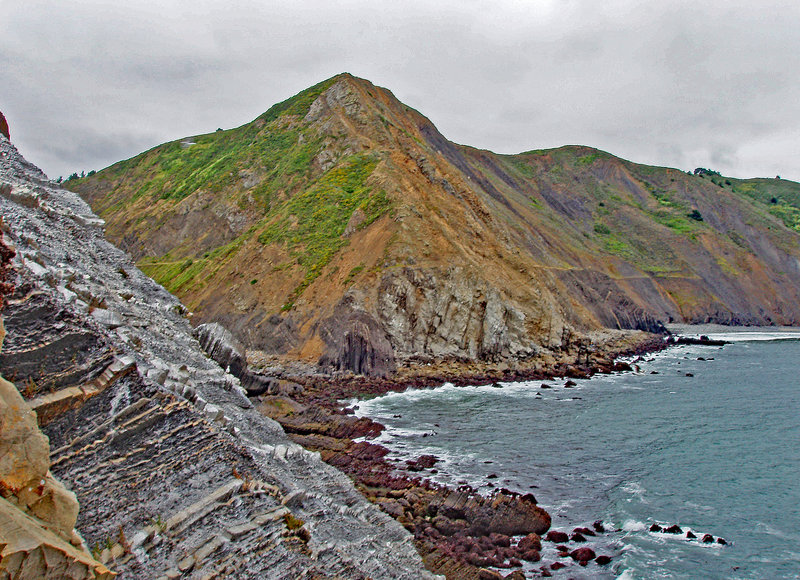 Looking towards Pedro Point Headlands. The grade line for a train that went around the headlands is still visible. The route was quickly abandoned because the land is too unstable to be maintained.