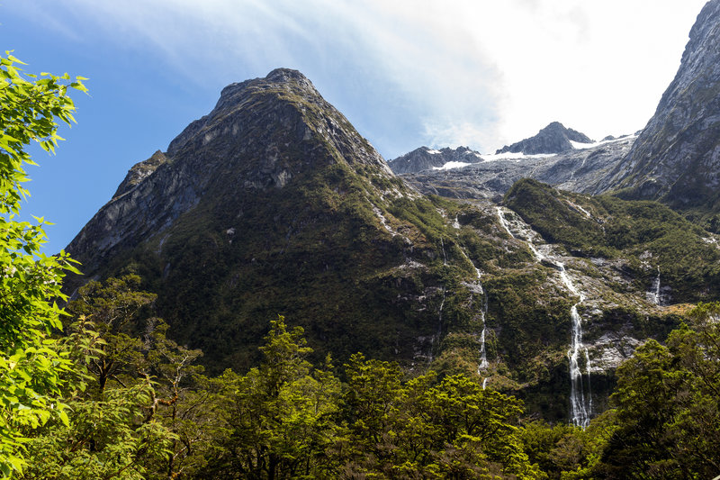 The mountains and waterfalls above Hirere Falls Shelter