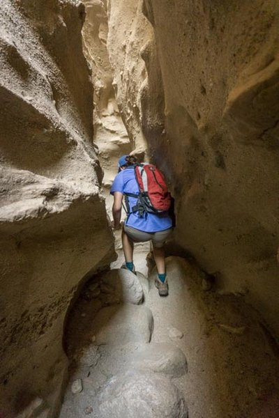 Stepping down into the slot canyon