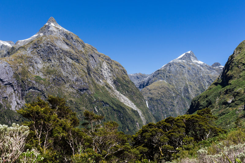 The first view of Sutherland Falls from the Milford Track. Mount Hart to the left and the Twin Sisters to the right.