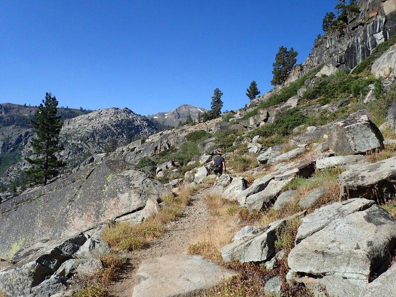 Climbing past the granite cliffs