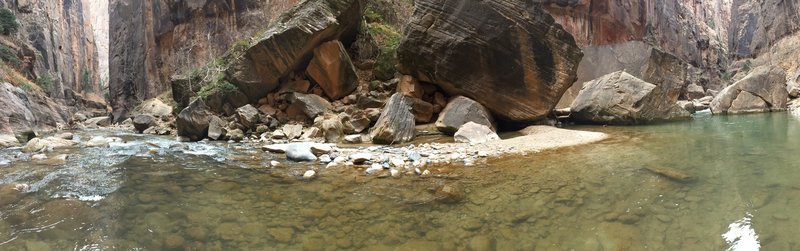 Boulders and deeper waters.