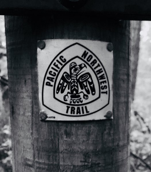 Pacific Northwest Trail marker, at the base of Goose Rock.
