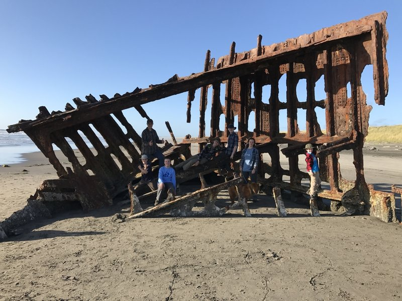 A group poses on the wreck.