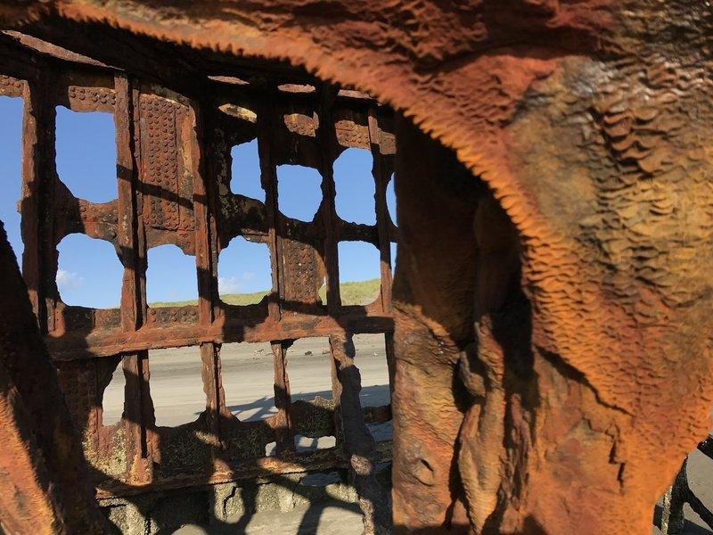 A hole rust ate between steel beams.