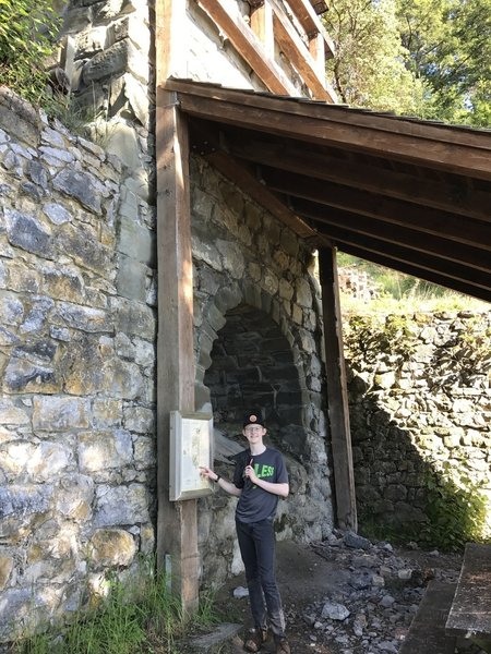 A young hiker poses next to the Kiln.