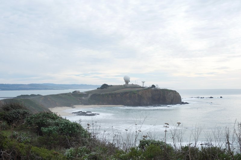 Pillar Point Air Force Station sits off in the distance above the Pacific.