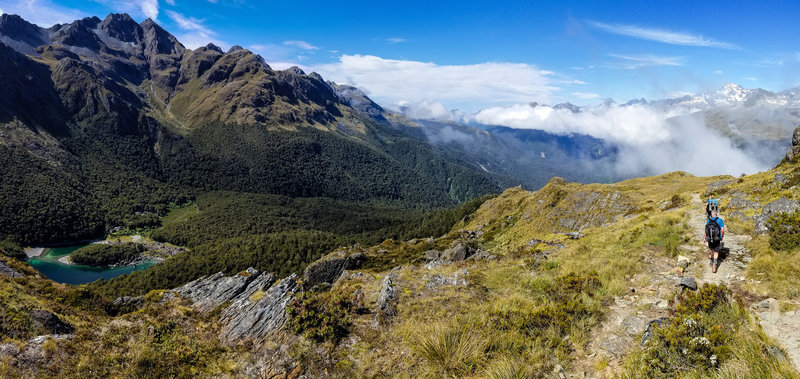 Panorama from the Routeburn Track with Lake Mackenzie to the left and the clouds moving into the Hollyford Valley to the right