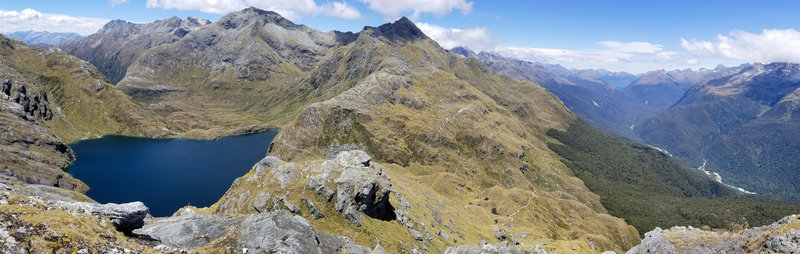 Panorama across Lake Harris, Harris Saddle, and the Hollyford Valley
