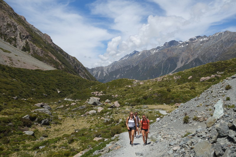 Hikers approaching the end of the Hooker Valley Track