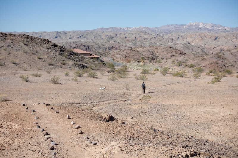 Near the beginning of the trail before the Ranger substation. You enter the hills and dunes past this point.