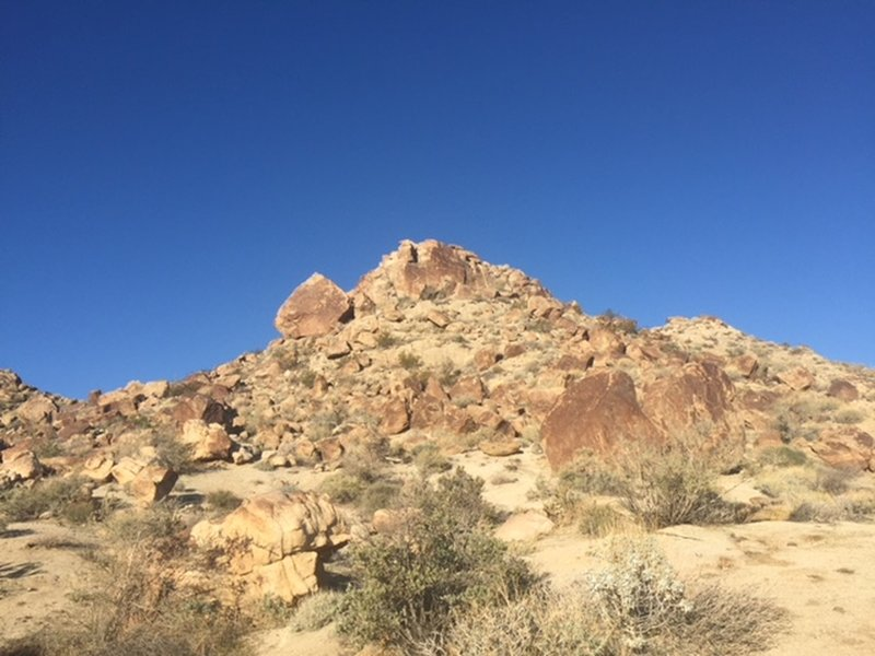 View west of some of the rocky terrain that you'll pass.