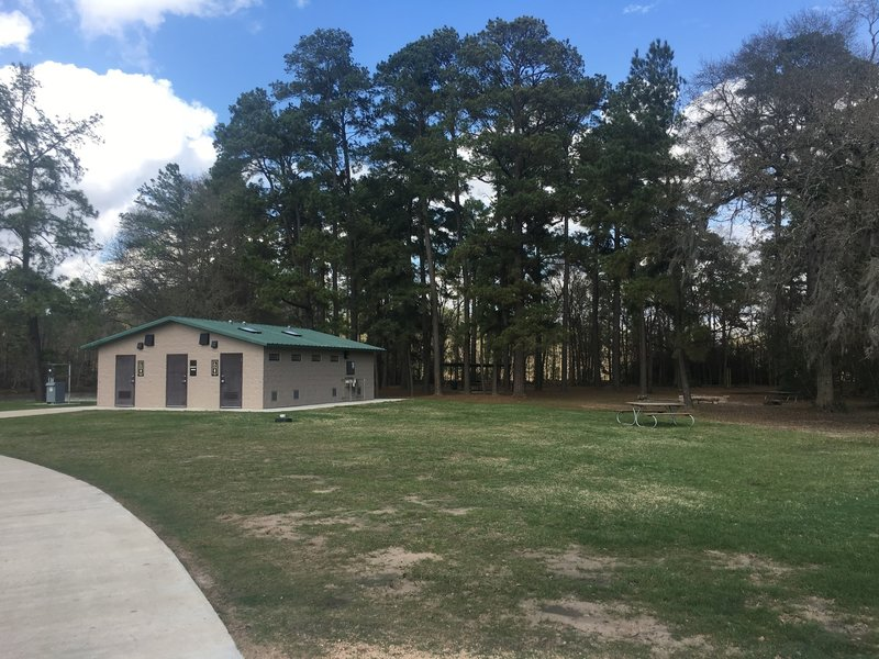 Public restrooms, tables, and sand volleyball, and piers over the lake are all available at the start of the trail near the larger parking lot.