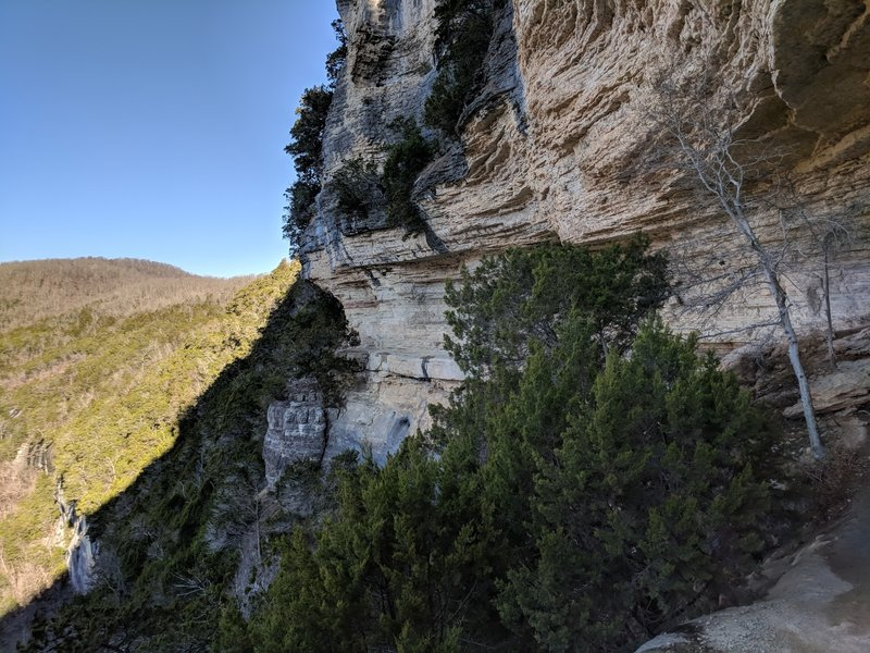 The trail follows this rock face. Dont worry the trail is wide.