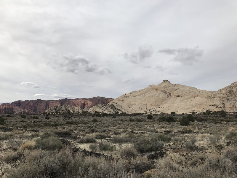 """From the Whiterocks Trail parking lot - this is still a fee area, even though technically just outside the north entrance to Snow Canyon SP.  The """"pimple"""" dome in the forefront."""