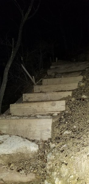 Top of ridge. Wooden stairs. Was lovely at night. Could hear water dripping off the rocks.