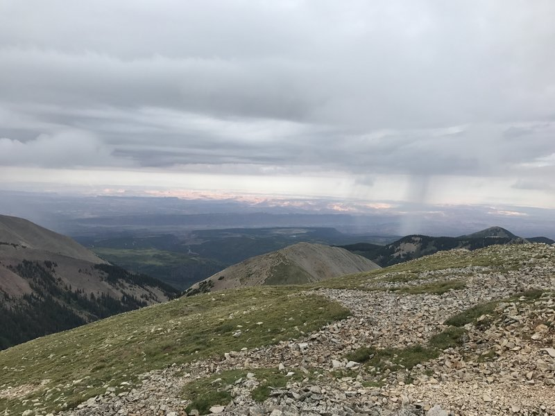 Summer storm off in the distance. View from the summit of Manns Peak