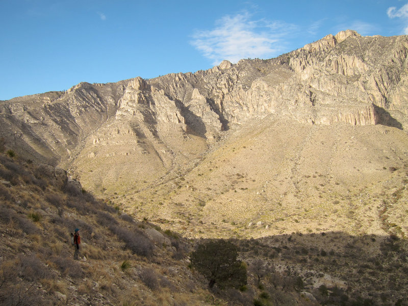 Hiker and Pine Spring Canyon from Guadalupe Mountains National Park, Guadalupe Peak Trail.
