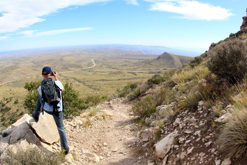 Tourist and hiker taking pictures on the Guadalupe Peak Trail.