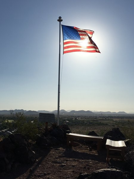 A flag pole, bench and guestbook gives hikers a place to reflect on the sacrifices of our veterans.