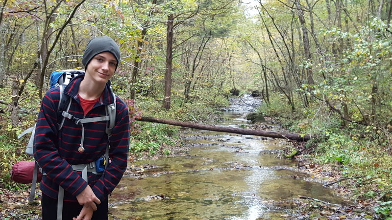 Crossing Brushy Creek on an October hike.