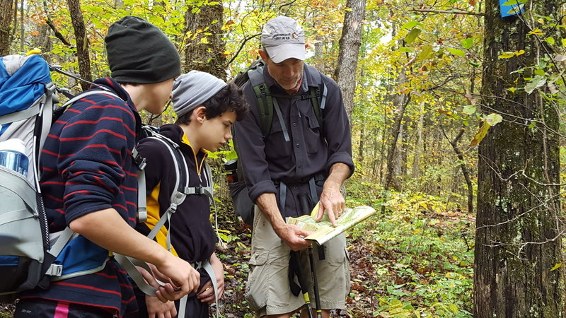 Checking the map on an October hike.