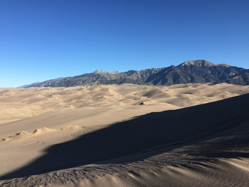 The juxtaposition of the dunes and the mountain is transfixing