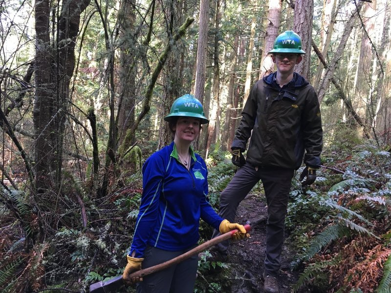 Two trail builders pose on the trail.