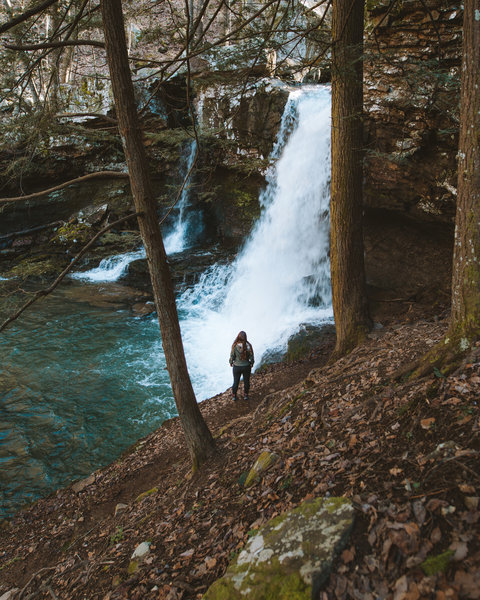 Travel companion looking at the third of three waterfalls that can be seen along the gorge trail at Cloudland State Park.