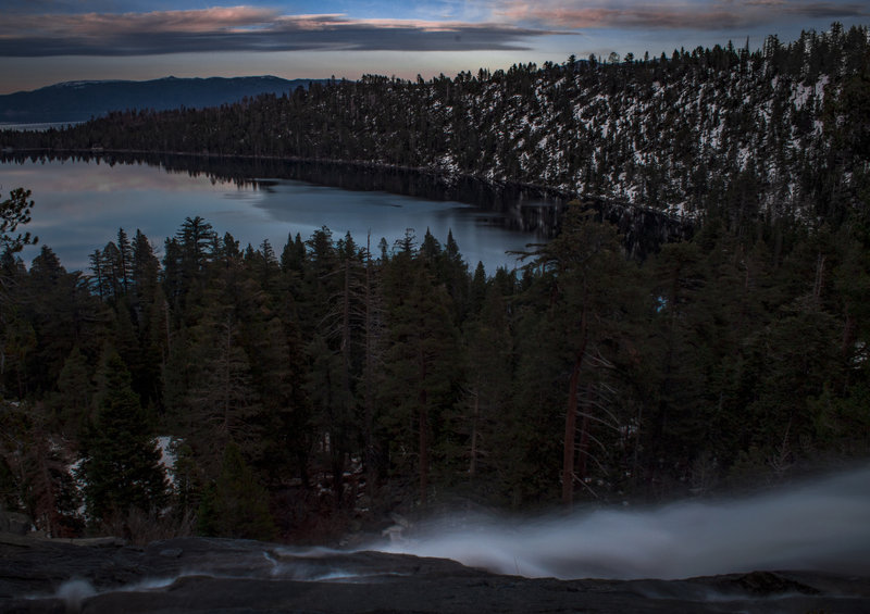 Top of Cascade Falls overlooking Cascade Lake shortly before sunset. Lake Tahoe and surrounding peaks in background.