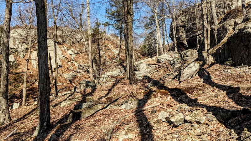 Dark shadows play among interesting rock formations on the Long Path is Harriman State Park