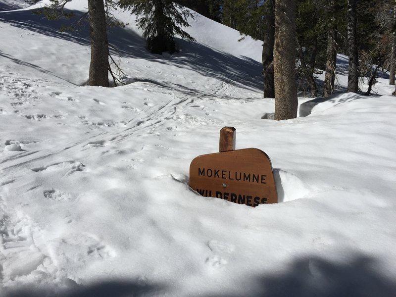 Late April snow nearly buried the sign at the beginning of the trail.