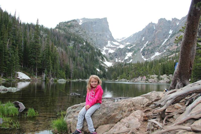 My daughter resting by Dream Lake in July 2017.