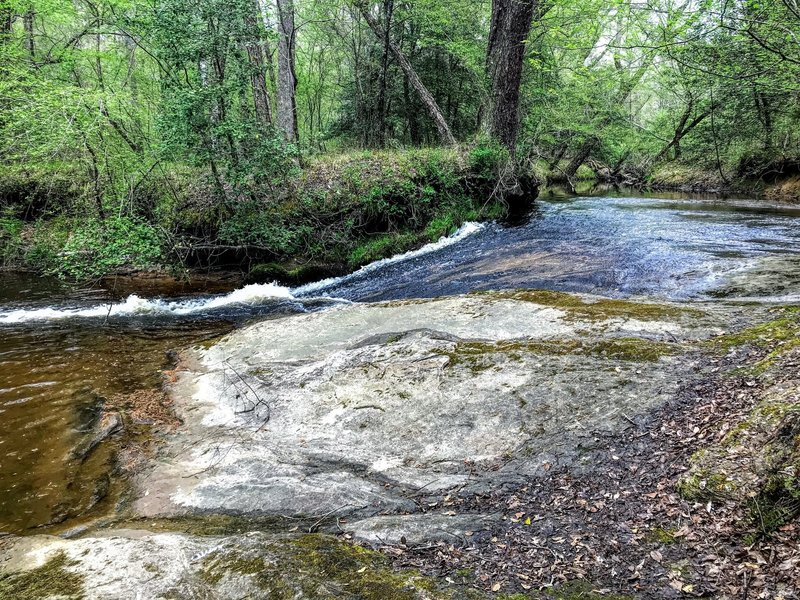 The creek running over smooth rock