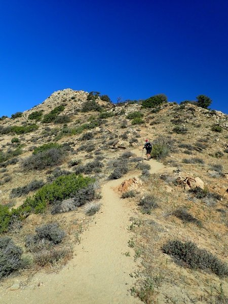 A little steepness just below the top