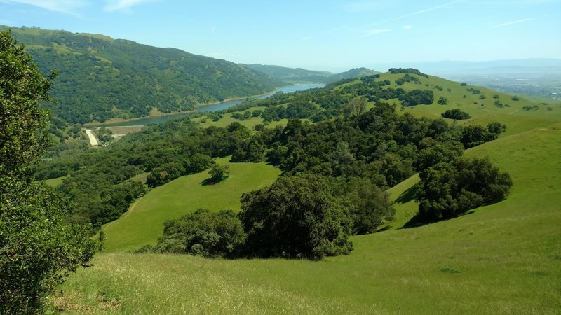 Left to right - Palassou Ridge, Coyote Lake and dam, Coyote Ridge, and southern Santa Clara Valley with central California in the far distance, looking southeast from the high point of Ed Willson Trail.