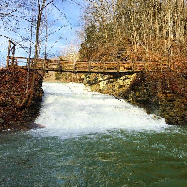 Suspension bridge over spillway